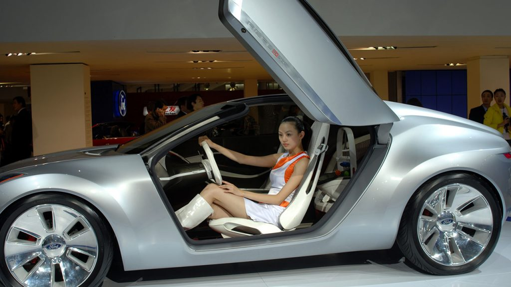 Woman in futuristic car