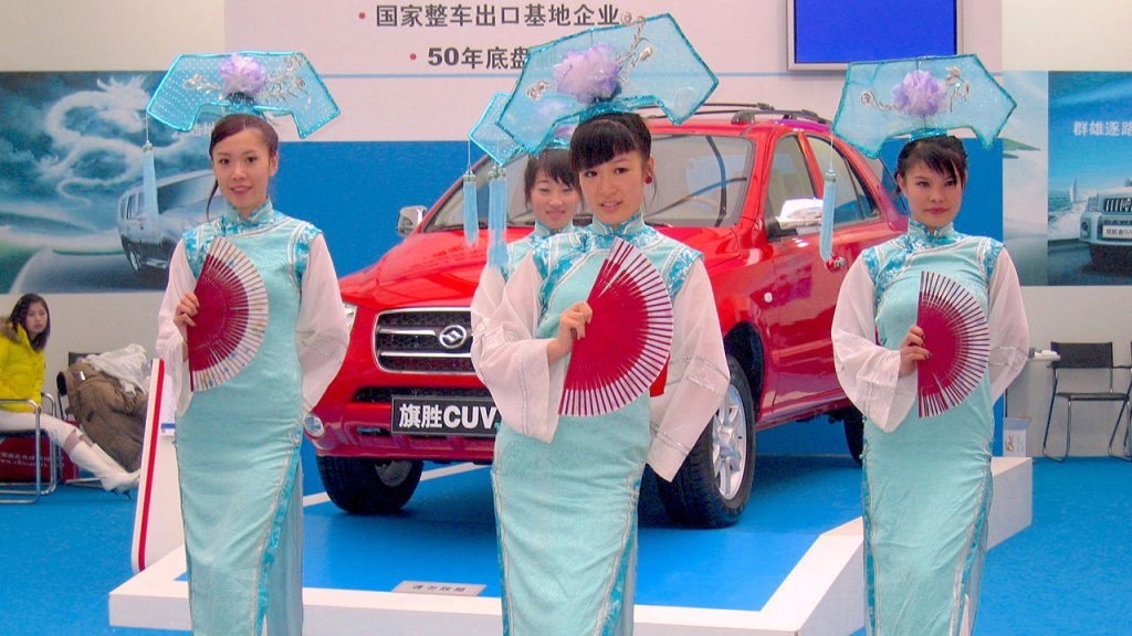 Chinese women in costumes at car show